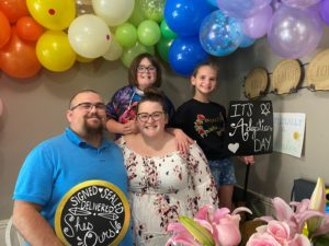Jacob, 11, Nevaeh, 9, Sam and Emily on the day Nevaeh's adoption was finalized.